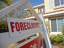 Foreclosures Fell to Record Low in 2020 Amid Virus Relief